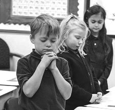 Saying the rosary prayer in the classroom at noon together with the 'Brother' school principal.