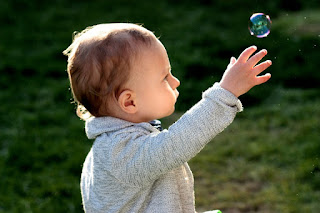 Bubbles can encourage reaching