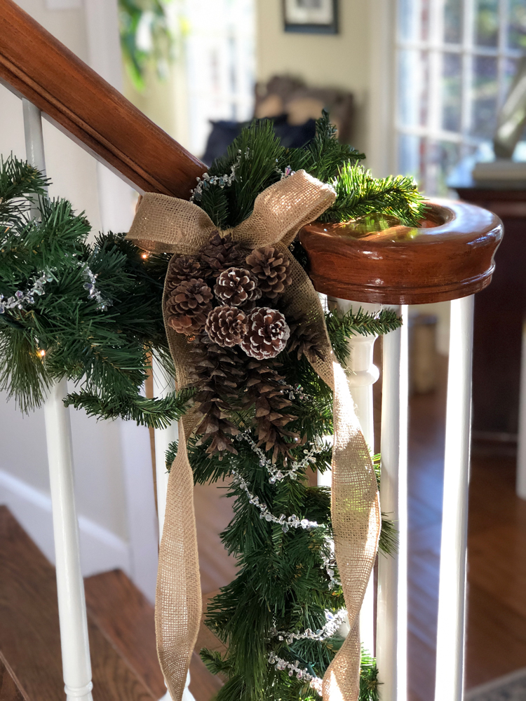 christmas garland with pine cones and burlap ribbon