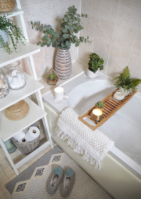 How to give your small bathroom a quick, simple and budget-friendly makeover, using accessories only. Featuring tips on how to maximise space, trick the eye into making the room look bigger, incorporate storage into your interior design, and how small can still be stylish. Artificial plants and greenery add a natural touch without the commitment of live plants, and a bath shelf makes more of the space.