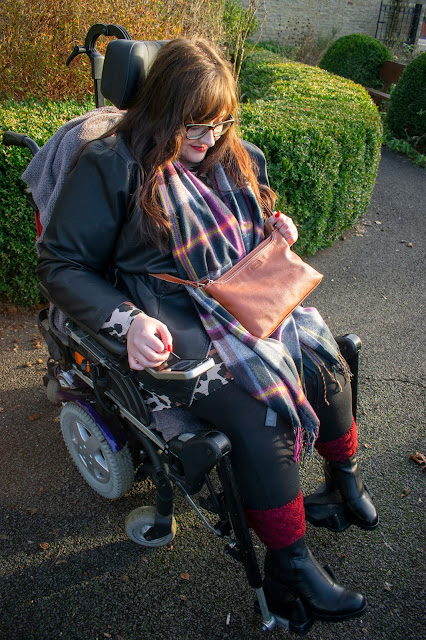 Plus size woman in powerchair wearing brown Mia Tui bag