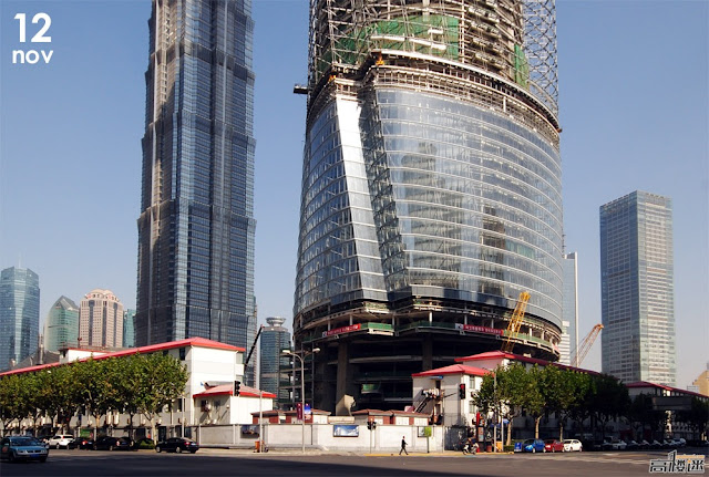 Photo of Shanghai Tower base under construction as seen from the across the street