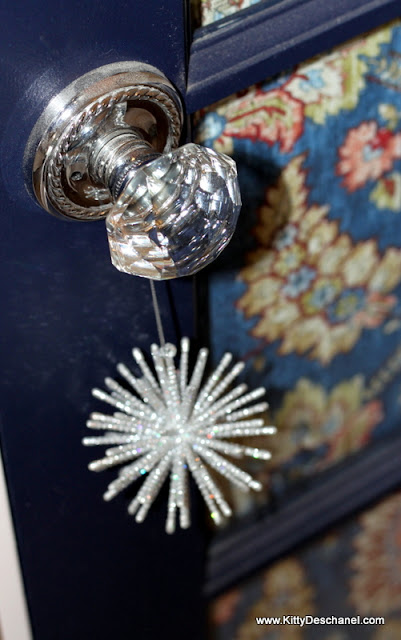 crystal doorknob and blue door