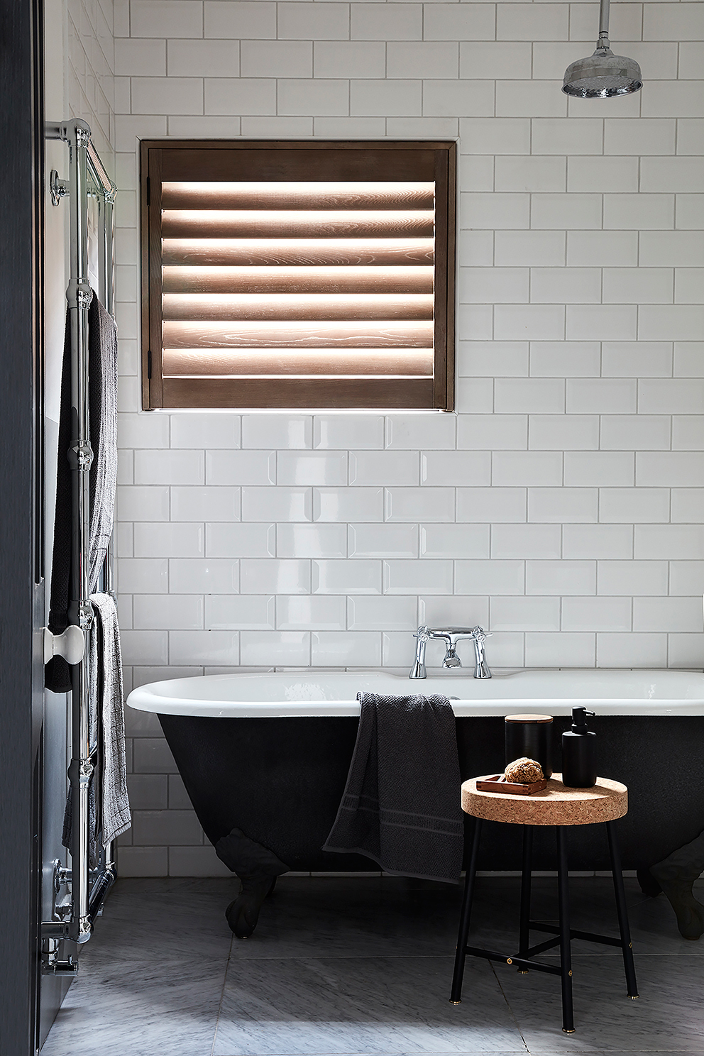 Shutterly Fabulous - French For Pineapple Blog - nautral wood shutter in bathroom with white subway tiles and black claw footed bath