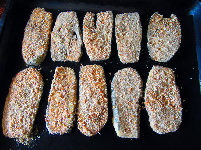 Baked breaded eggplants with salsa and cheese by Laka kuharica: place breaded slices onto a large baking sheet