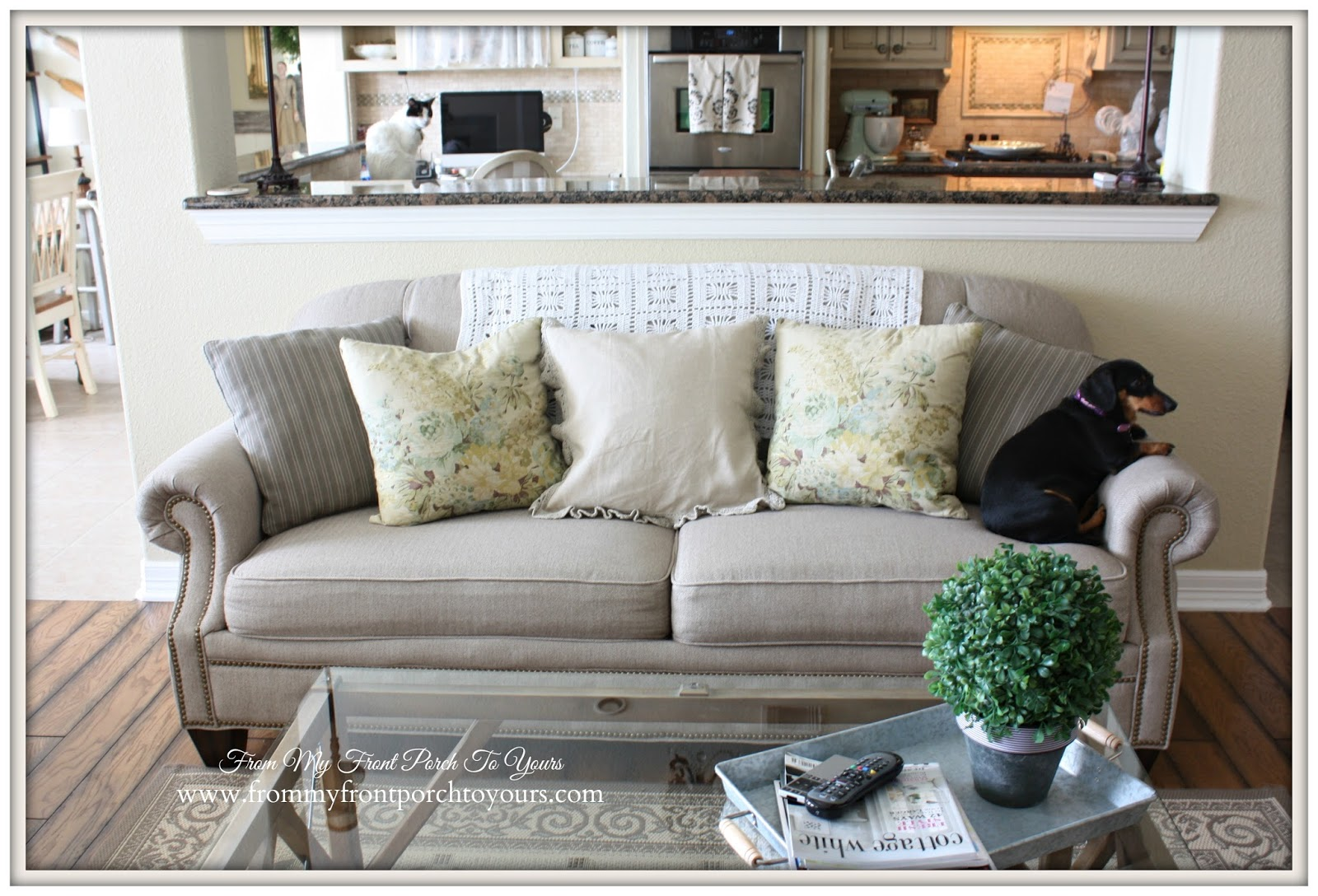 Floral Pillows by French Laundry adorn a Flex Steel Tufted sofa over at From My Front Porch To Yours.