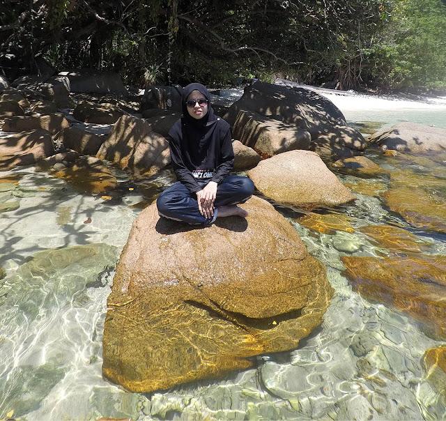 Meditation on rock at Pulau Perhentian