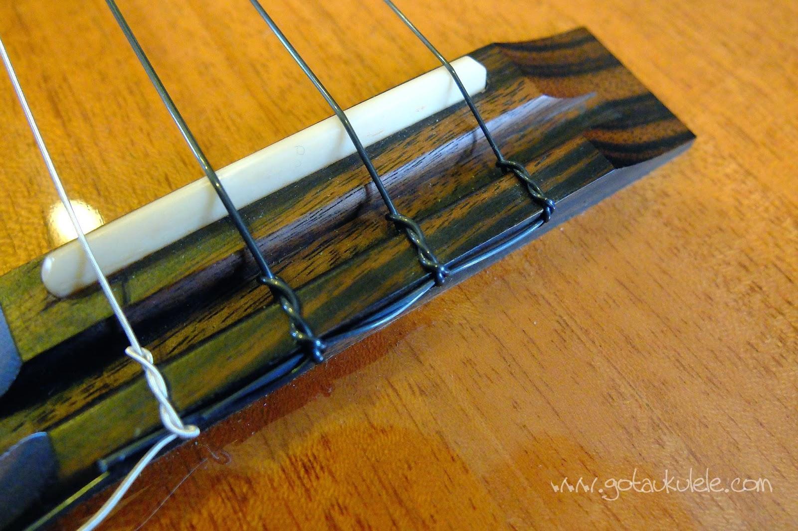 Aquila Lava Ukulele Strings on Pono bridge