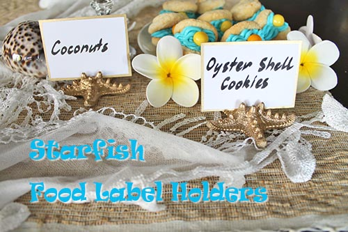 Tropical afternoon tea buffet with gold starfish food label holders.