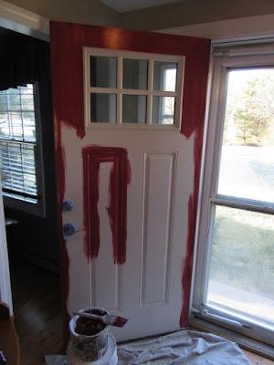 entry door being painted 1st. coat.