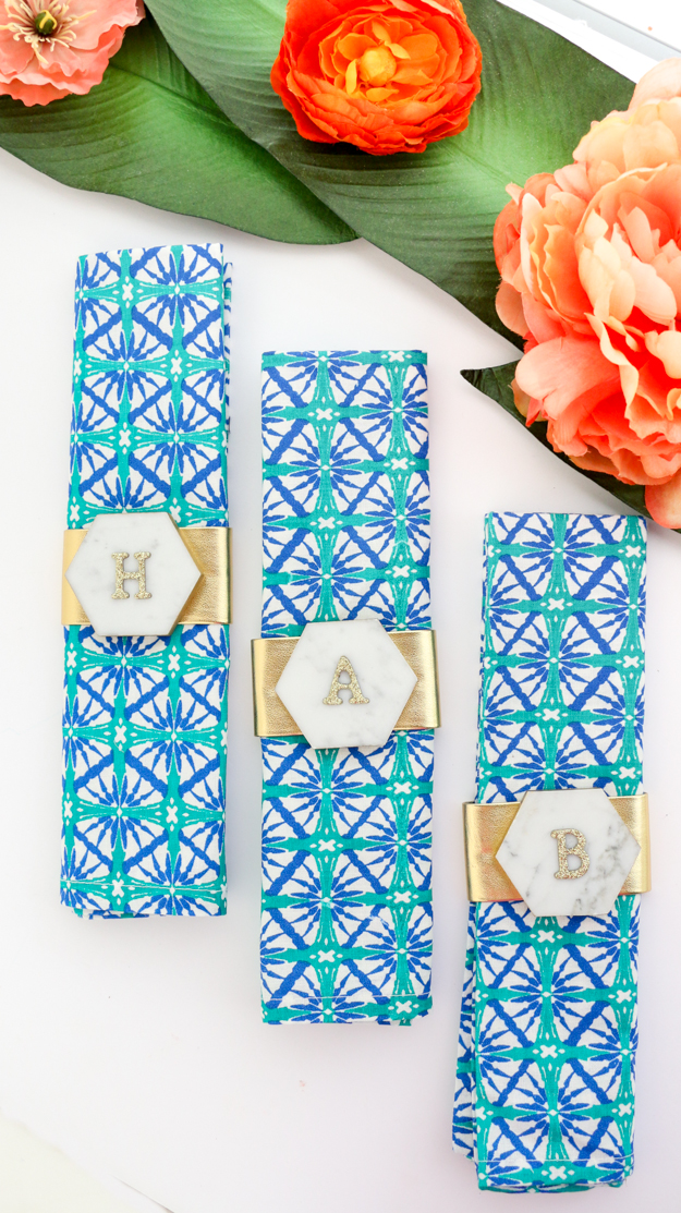 DIY your own marble and gold napkin rings using hardware store hexagon tile. Easy dinner party decoration idea - monogramed place cards - monogram napkin rings - diy home decor