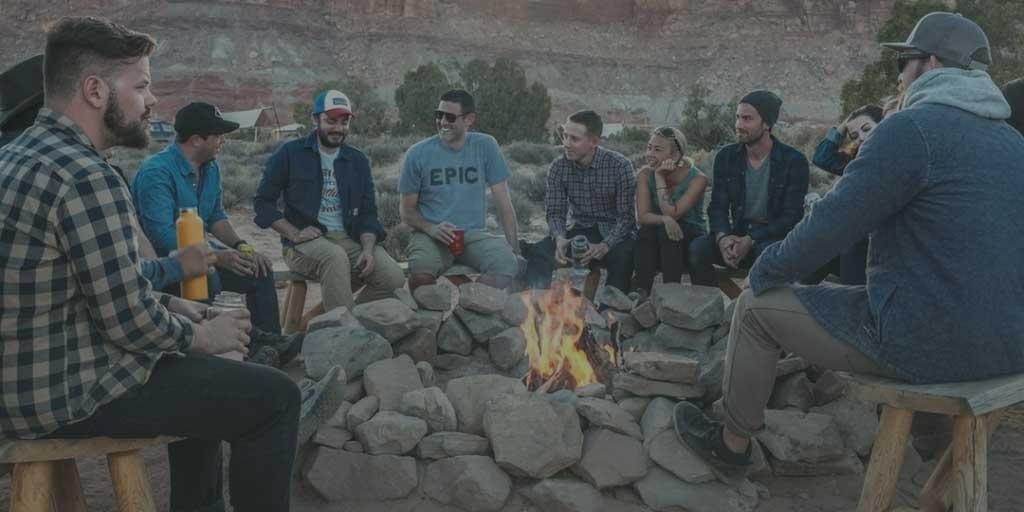 Friends sitting around a campfire