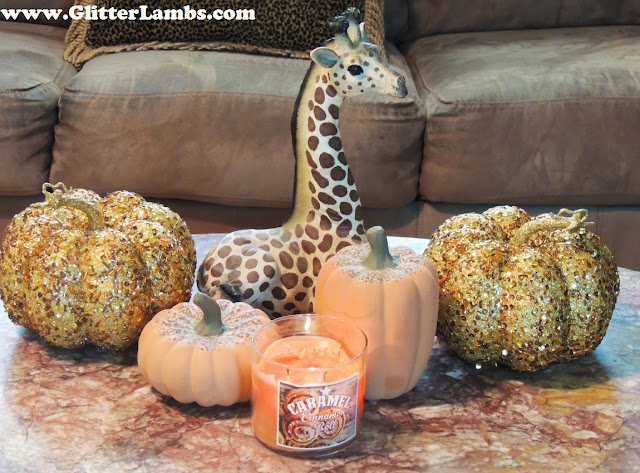 I have my two gorgeous glitter sequin pumpkins sitting next to my delicious Caramel Cinnamon Roll candle that I have buring. These pumpkins are just so PRETTY!!!