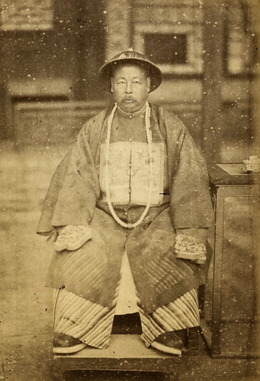 Zuo Zongtang in 1875 wearing military garment with long court beads.