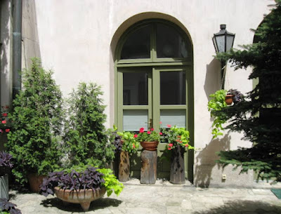Sunny doorway with planters