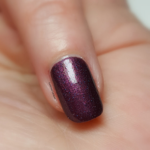 Red-nail-polish-with-blue-holographic-glitter