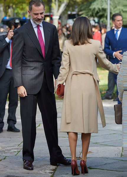 Queen Letizia wore Pedro del Hierro Checked dress and Magrit red pumps, carries Magrit clutch bag. She wore a Checked Dress by Pedro del Hierro