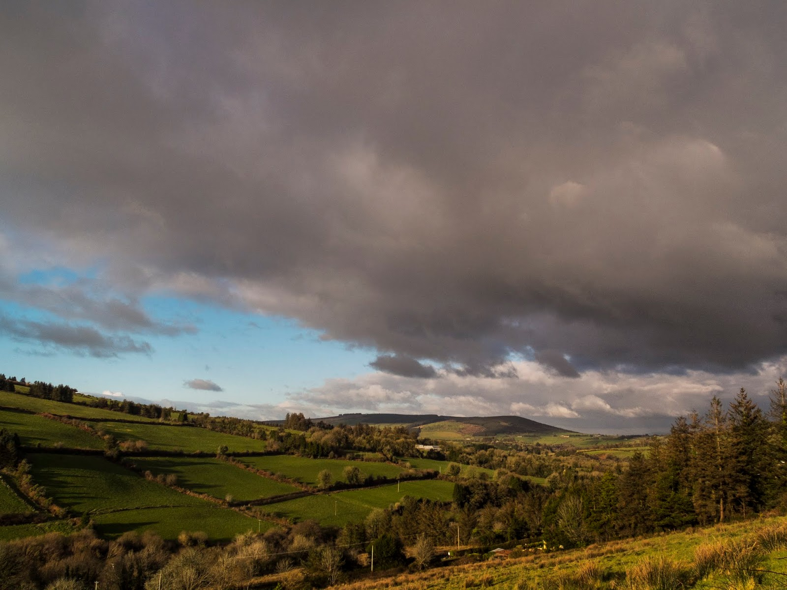 Dark clouds over a valley in North Cork.