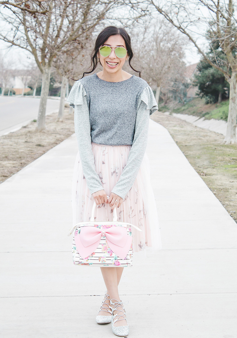 modest outfit featuring refashioned ruffle sweater laughter pose
