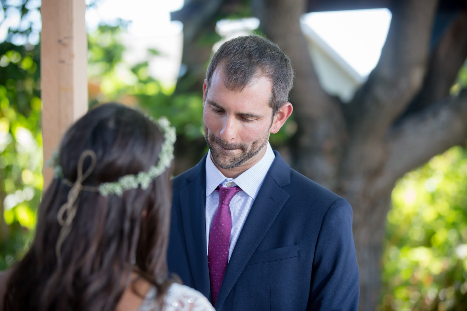 Groom holding back the tears during brides vows
