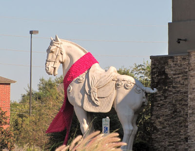 P. F. Chang's war horse with pink sash for breast cancer awareness
