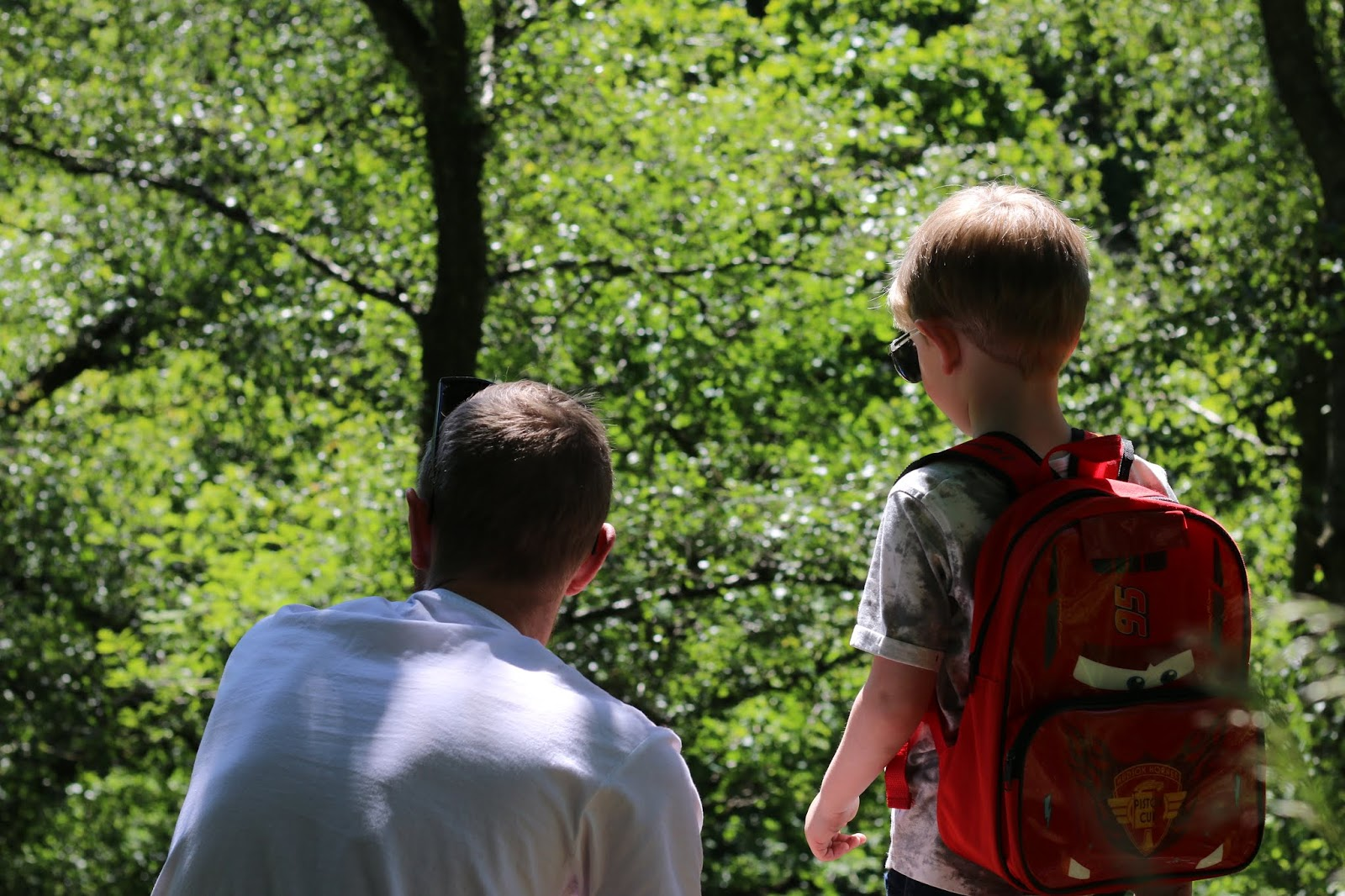 my son playing with his dad in the woods