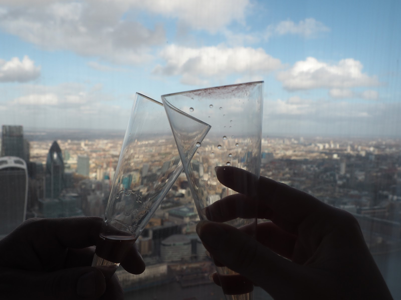 Champagne toast with London City behind