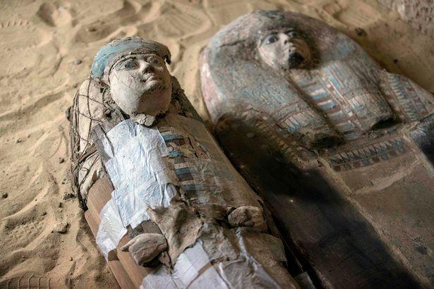 Sarcophagi are seen inside a burial shaft at the Giza pyramid plateau