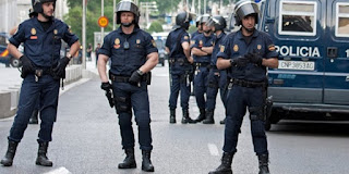 Spanish police raided government departments in Catalonia and arrested a local minister