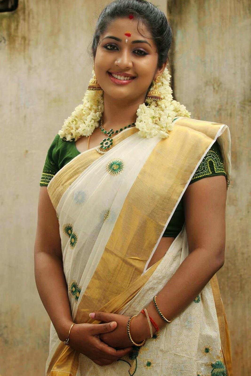 Actress Navya Nair Beautiful Saree Stills - Cap-9885