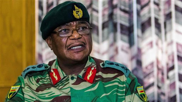 Army general who led coup against Mugabe sworn in as vice president