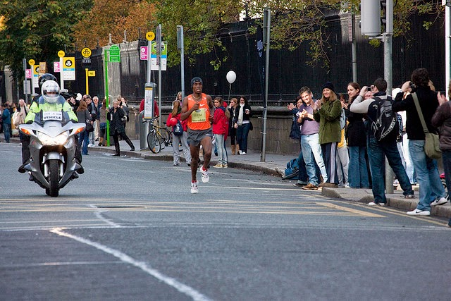 Photograph of Feyisa Lilesa on his way to winning the Dublin Marathon in 2009