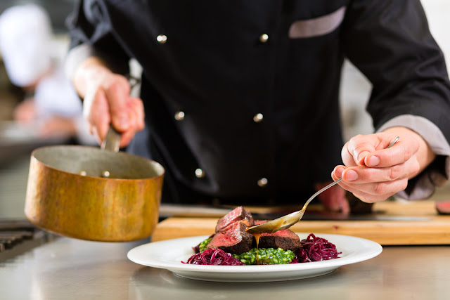 Chef drizzling sauce over dish at one of Reykjavik's best restaurants