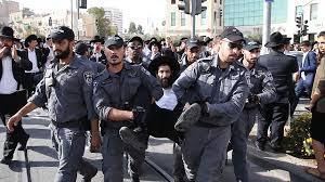Clashes between Israeli police and Jews protesting against recruitment