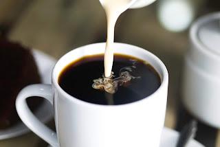 Coffee in white ceramic mug while pouring milk - Sarah Shaffer - Unsplash: https://unsplash.com/photos/XEwsH1VUHTg