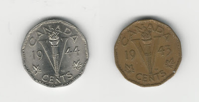 Two coins the same size but of different metals.
