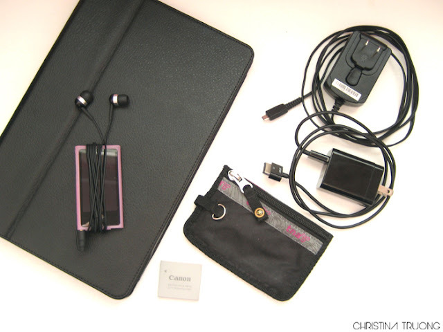 What's In My Bag ASUS Transformer. iPod nano with Multi-Touch. Canon battery. TNA coin pouch. Tablet. Phone chargers.