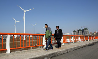 Wind turbines in Tianjin. China and the EU say they are determined to forge ahead with Paris and accelerate the global transition to clean energy. (Photograph Credit: Bloomberg/Bloomberg via Getty Images) Click to Enlarge.