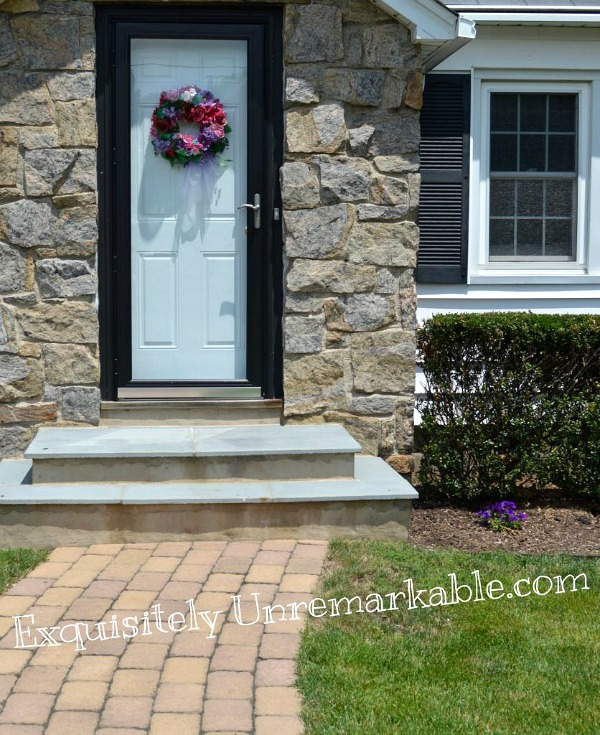 White Front Door With Black Framed Storm Door