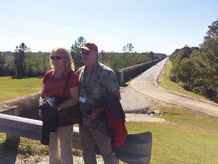 OC Astronomers Scott and Sandy look at lab with other LIGO arm receding in the distance (Source: Palmia Observatory)