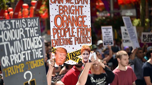 Miles de personas protestan contra Trump en Australia e Indonesia