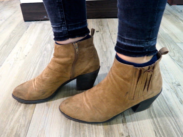 Zig Zag - outfit shoe details of low heeled brown suede ankle boots, worn wit =h grey ragged hem skinny jeans