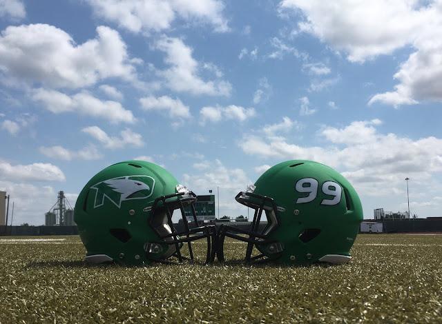 North Dakota Fighting Hawks logo helmets