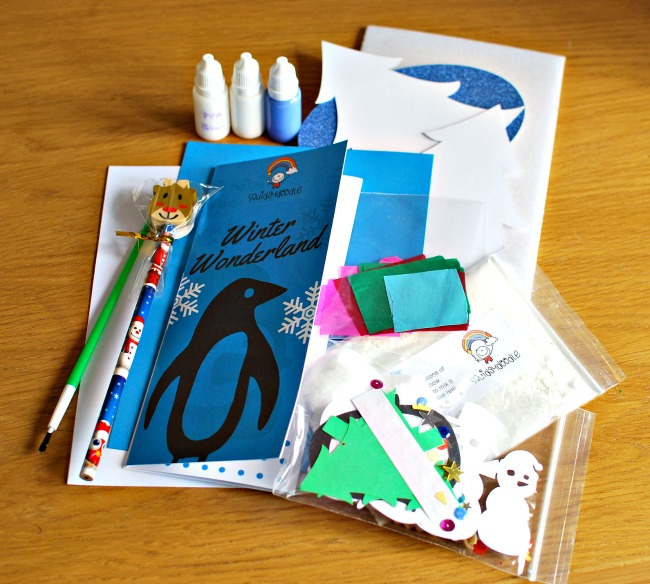 contents-of-inside-the-squidgydoodle-subscription-box-spread-onto-wooden-table-top