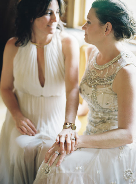 The brides share a moment in a private room above the barn at Jonna and Heather's Inn at West Settlement Wedding by Karen Hill Photography