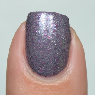 gray crelly nail polish with silver and red flecks