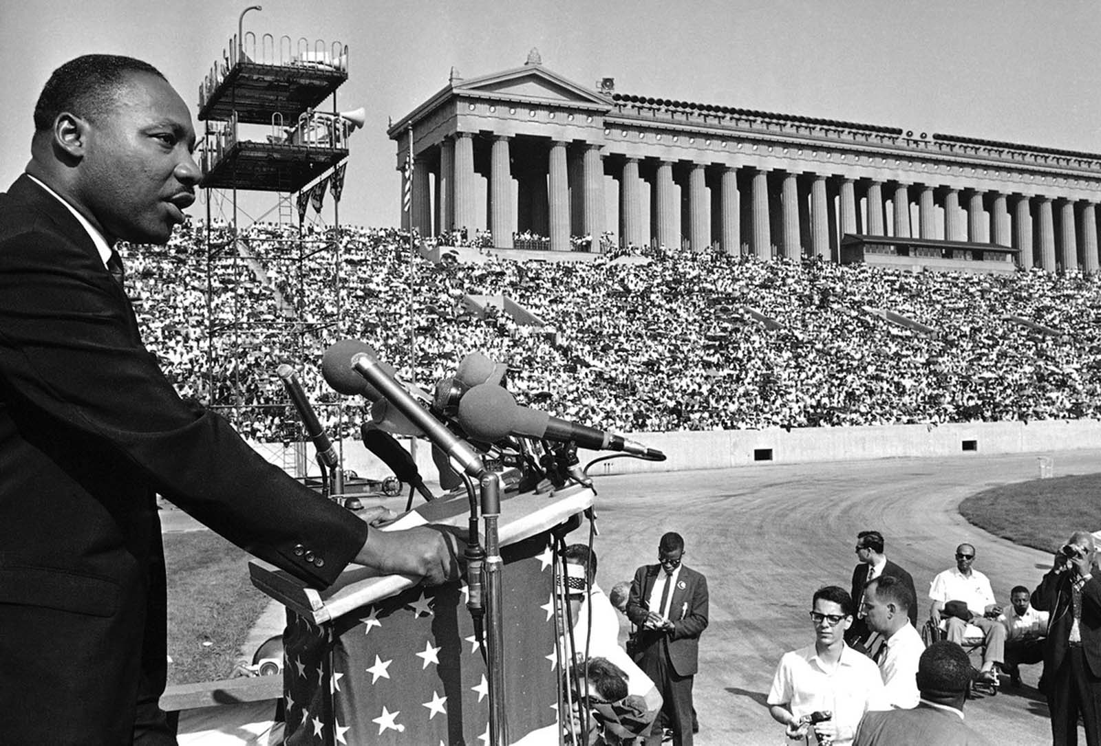 The Reverend Martin Luther King addresses a crowd estimated at 70,000 at a civil rights rally in Chicago's Soldier Field, on June 21, 1964. King told the rally that congressional approval of civil rights legislation heralds