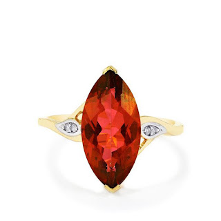 Image showing a deep red topaz ring. The topaz is Cruzeiro, revived by Gemporia from a Brazilian mine