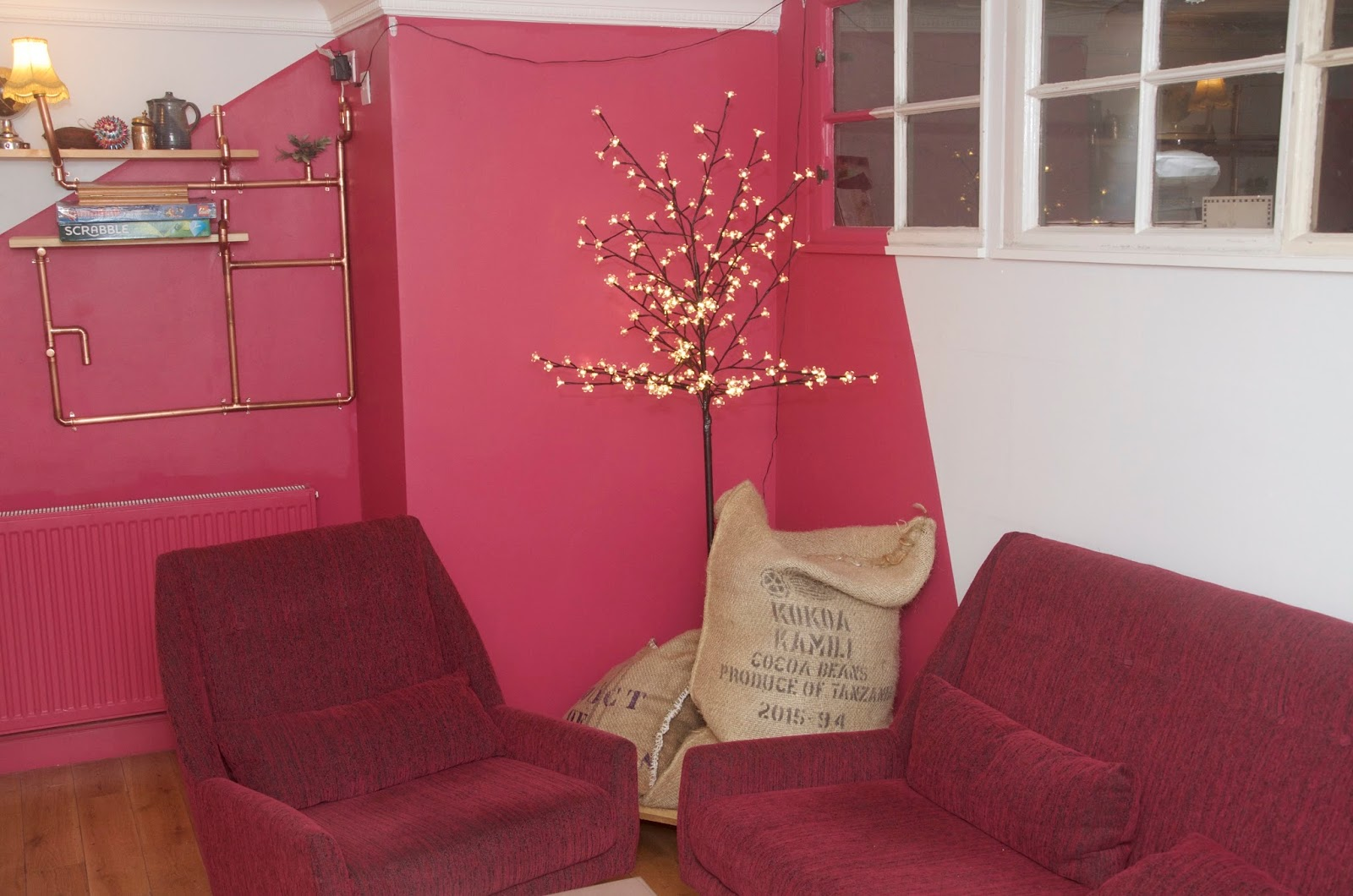 fairy lights, tree and pink couches