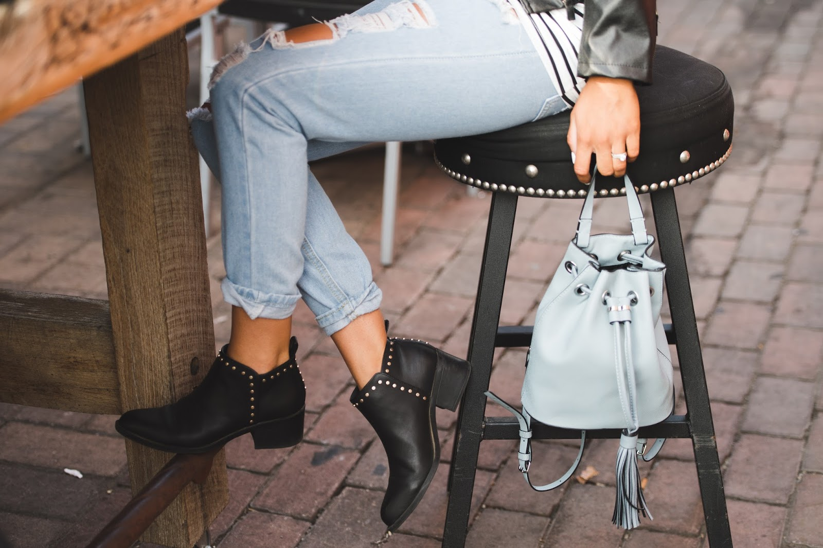 Ripped Denim and Studded Boots \\ @taylorwinkelmeyer